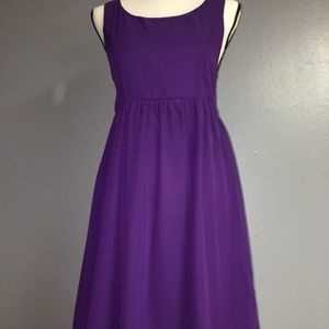 Purple dress with gold embellishment.